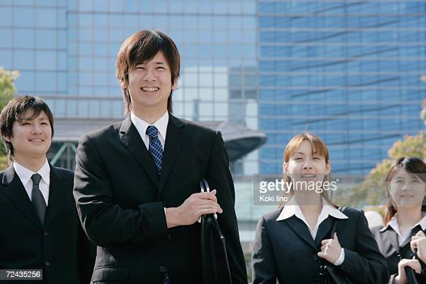 Four young businessperson standing