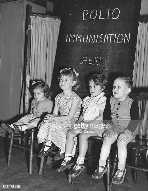 Four young children wait to have their polio vaccinations at the Fairfield Welfare Clinic