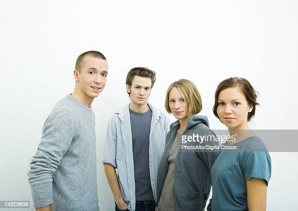 four young friends, looking at camera, portrait - four people stock pictures, royalty-free photos & images