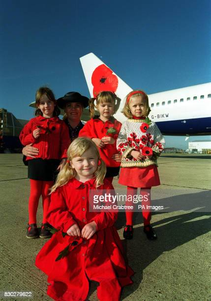 Four young girls called Poppy are joined by a British Airways hostess to mark the airline's British Legion Remembrance Day campaign by painting a...