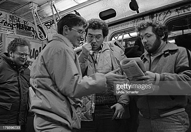 Four young Jewish men wearing the traditional Orthodox Yamaka, find an article in the newspaper of interest. This was during the Mayor Koch era when...