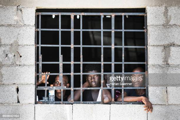 Four young men are pictured in a Detention Center on June 08, 2017 in Tripolis, Libya. A detention center place where illegal migrants are arrested.