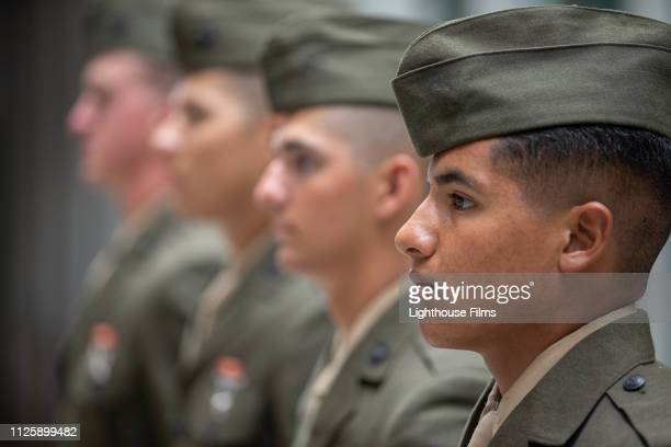 four young men in uso uniform stand in a row at attention. - north carolina amerikaanse staat stockfoto's en -beelden