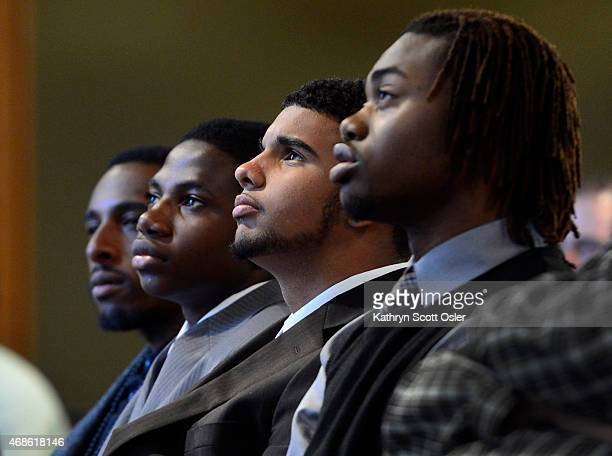 Four young men that addressed the summit are from left to right Michael Acuna a facilitator for My Brother's Keeper and high school students Peter...