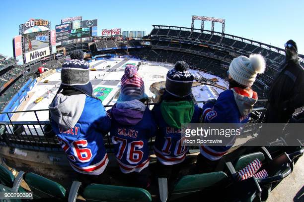 Four young New York Rangers fans look down at the ice prior to the 2018 Winter Classic between the New York Rangers and the Buffalo Sabres on January...