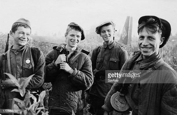 Four young partisans who just set fire to a junkers52 a german transport plane that made a forced landing world war 2