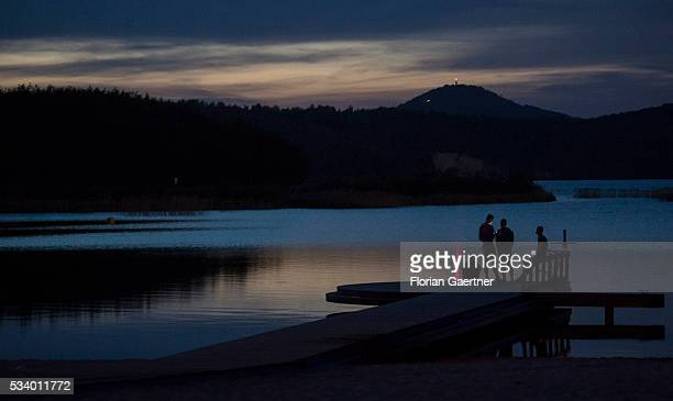 Four young people are captured in front of the lake 'Berzdorfer See' in the evening on May 22 2016 in Tauchritz Germany