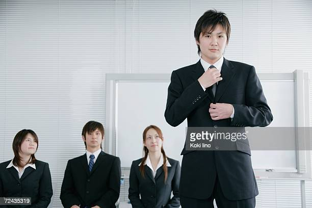 Four young people having job interview