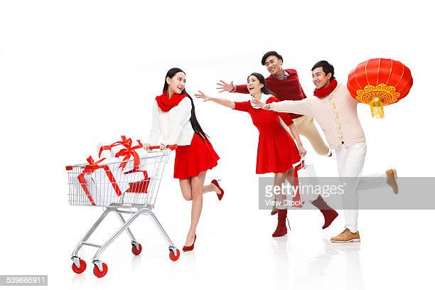 Four young people on holiday shopping