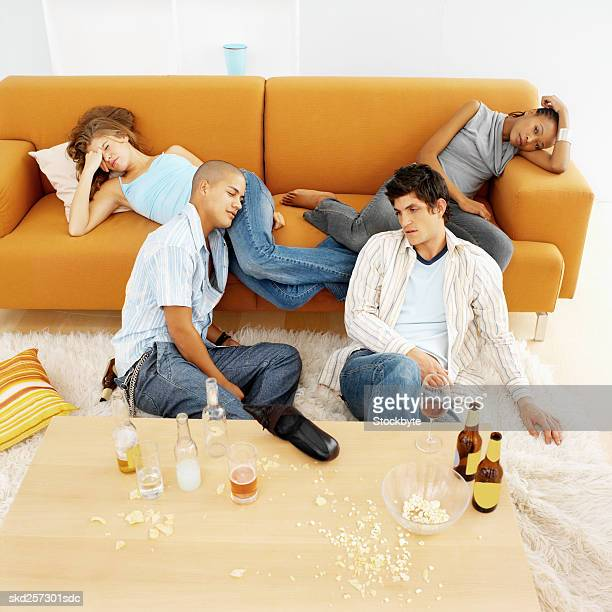 four young people sleeping after party - messy table after party stock pictures, royalty-free photos & images