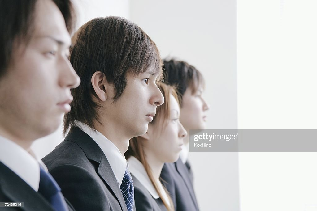 four young people waiting for job interview ストックフォト getty