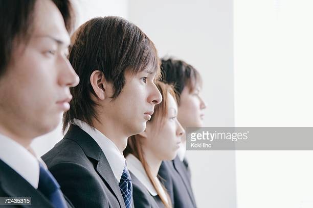Four young people waiting for job interview