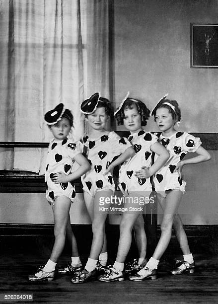 Four young tap students line up in the dance studio for a portrait