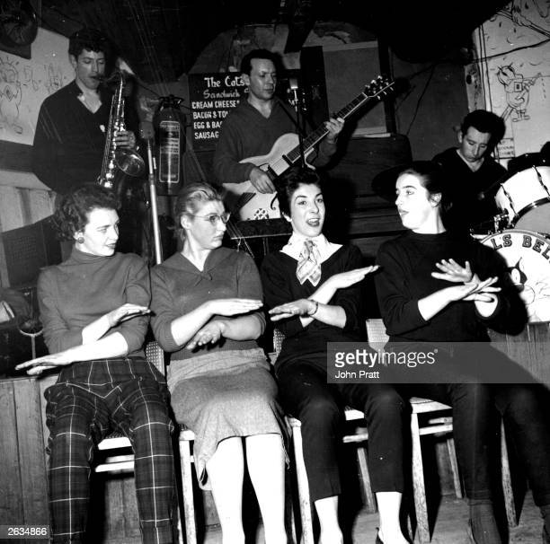Four 'young things', in a team known as the Kittens, perform the hand jive in the Cat's Whiskers coffee-bar in Soho to music from Leon Bell and the...