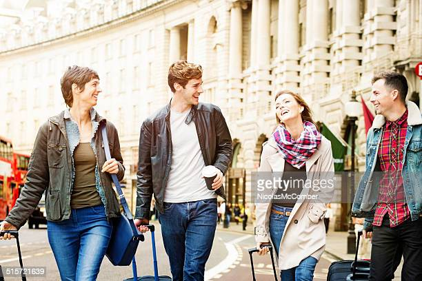 Four young tourists walking down Regent street in London