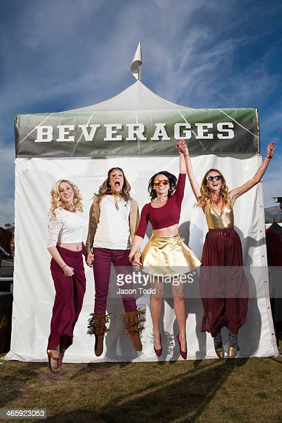 four young woman jumping at tailgate party - jason todd stock photos and pictures