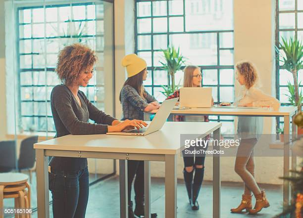 four young woman working at the office