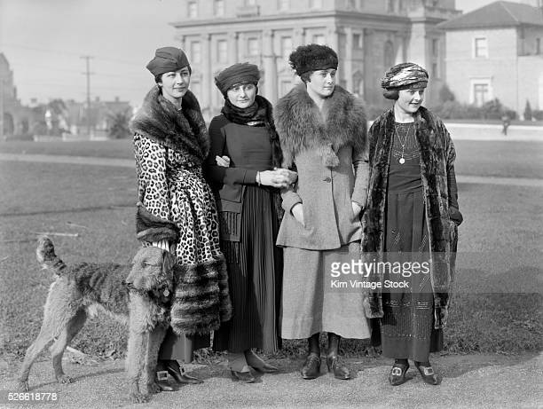 Four young women dressed in the high fashion of the day pose in San Francisco