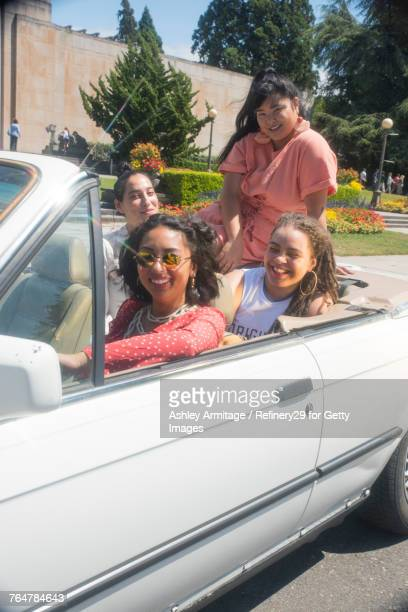 Four Young Women Hanging Out In Car