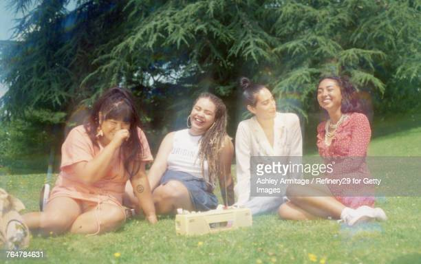 Four Young Women Hanging Out Outside