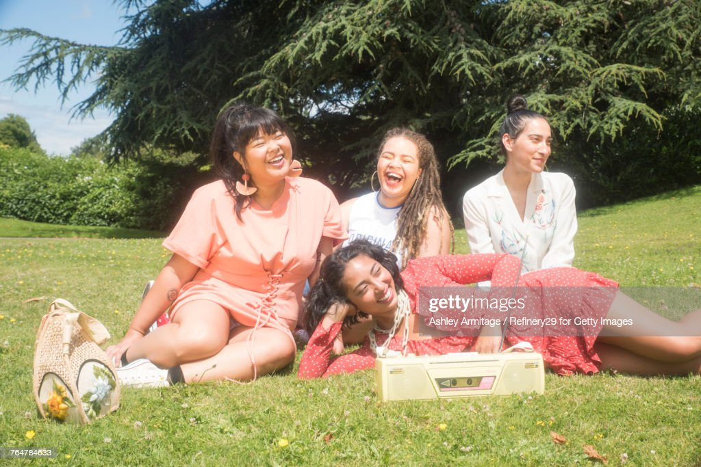 Four Young Women Hanging Out Outside : Stock Photo