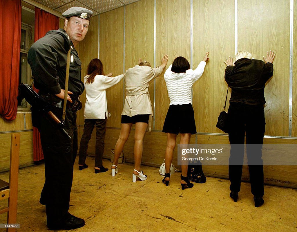 Four young women picked up by police for prostitution are made to stand against the wall after their arrest by Moscow police May 1997 in Moscow, Russia. Prostitution has become a major problem in Russia as low wages have driven women to search for a way to make money.
