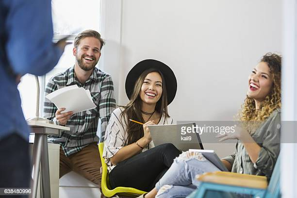 Four young worekrs in an office business meeting