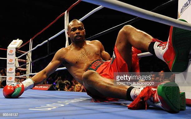 Fourdivision world champion Roy Jones Jnr of the US lies on the mat after being hit by Australian titleholder Danny Green during the IBO...