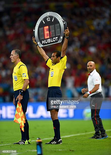 Fourh official Nawaf Shukralla displays the stoppage time during the 2014 FIFA World Cup Brazil Group B match between Spain and Chile at Estadio...