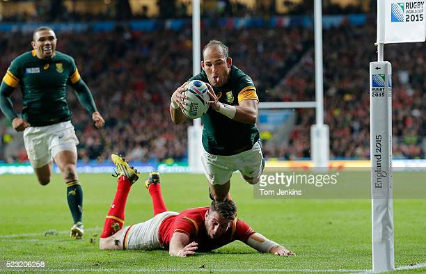 Fourie Du Preez dives in for the crucial winning try as Alex Cuthbert misses the tackle during the South Africa v Wales Rugby World Cup quarterfinal...