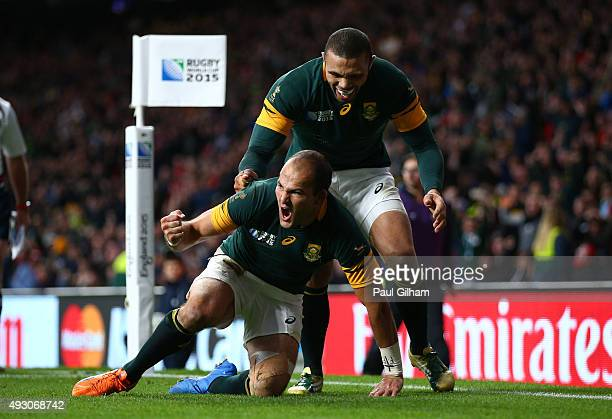 Fourie Du Preez of South Africa celebrates his try with Bryan Habana of South Africa during the 2015 Rugby World Cup Quarter Final match between...