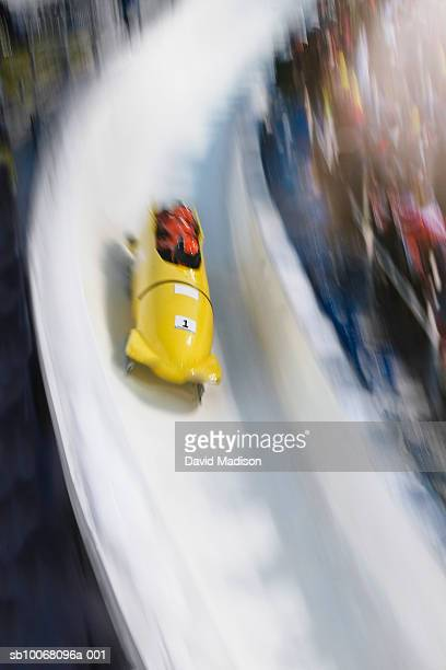 Four-man bobsled on track, blurred motion
