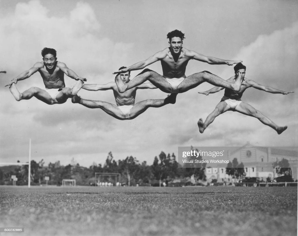 A four-man team of gymnasts from the University of California at Los Angeles exercise daily, with an eye on the Olympic games, Los Angeles, California, early to mid 20th century. From left, N Tabato, G Tiernana, J Jones, and B Landee.