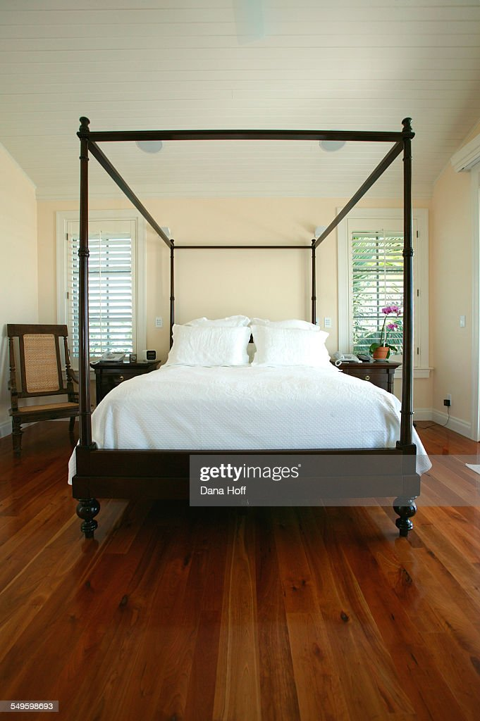 A Fourposter Bed In Dark Wood Defines Space In A Master Bedroom High Res Stock Photo Getty Images