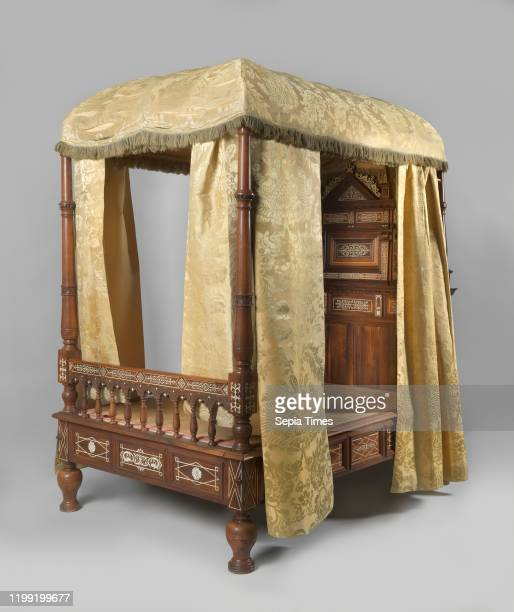 Fourposter bed in rosewood decorated with ivory inlay Rosewood crib decorated with ivory inlay The bed rests on vaseshaped legs The rule is divided...