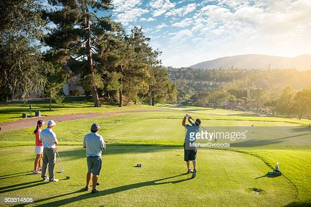 foursome of golfers - golf swing stock pictures, royalty-free photos & images
