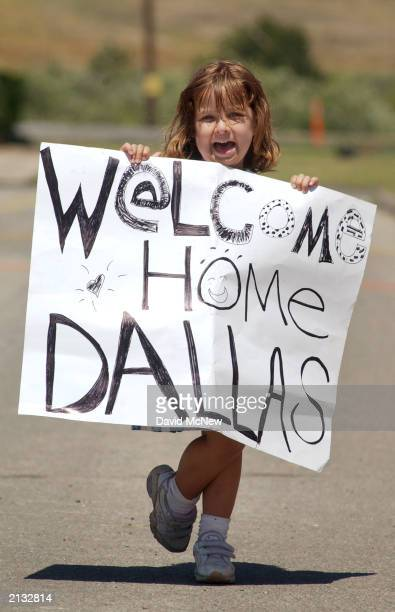 Fourtearold Noelle Baganz welcomes home her father Lance Cpl Dallas Baganz of 1st Battalion 11th Marine Regiment upon his return from Iraq July 2...