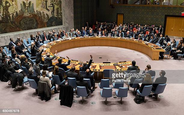 Fourteen members of the Security Council raise their hands in affirmation of Resolution 2334 The United Nations Security Council held a vote on...