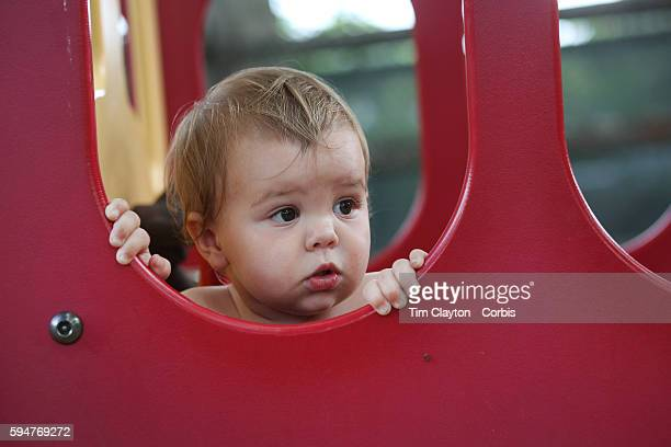 A fourteen month old baby girl in a playground setting during play Photo Tim Clayton