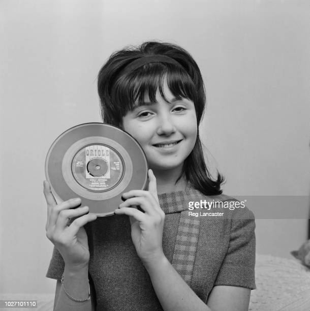 Fourteen year old English singer Adrienne Posta pictured holding a copy of her recently released debut single 'Only Fifteen' in London on 29th...