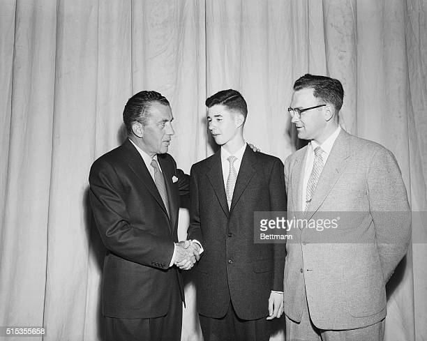 Fourteen year old William Cashore of Norristown, Pennsylvania, who won the 1954 National Spelling Contest, gets congratulated by television...