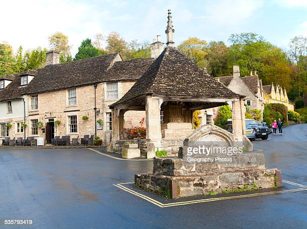 Fourteenth century stone market cross in Castle Combe Wiltshire England UK claimed to be Englands prettiest village