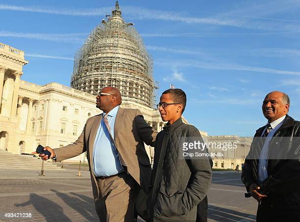 Fourteenyearold Ahmed Mohamed of Irving TX and his father and former Sudanese presidential candidate Mohamed Elhassan Mohamed are guided by family...