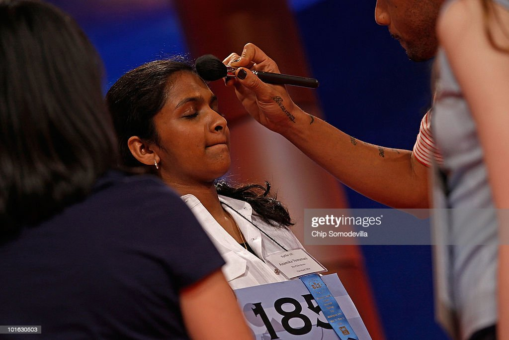 Fourteen-year-old Anamika Veeramani of Cleveland, Ohio, has a little makeup applied before spelling the winning word during the 2010 Scripps National Spelling Bee June 4, 2010 in Washington, DC. Veeramani spelled 'stromuhr' to win the competition.