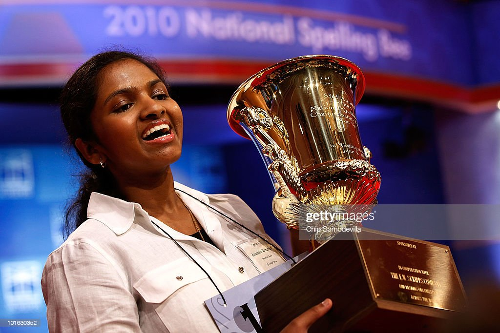 Fourteen-year-old Anamika Veeramani of Cleveland, Ohio, hoists her trophy after winning the Scripps National Spelling Bee June 4, 2010 in Washington, DC. Veeramani spelled 'stromuhr' to win the competition.