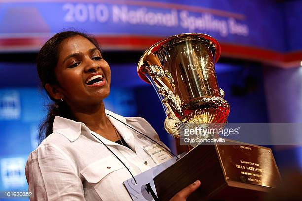 Fourteenyearold Anamika Veeramani of Cleveland Ohio hoists her trophy after winning the Scripps National Spelling Bee June 4 2010 in Washington DC...