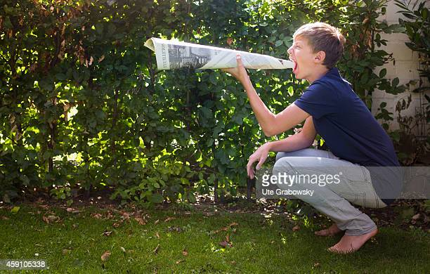 Fourteenyearold boy yelling through a megaphone made out of rolledup newspapers on August 11 in Duelmen Germany Photo by Ute Grabowsky/Photothek via...