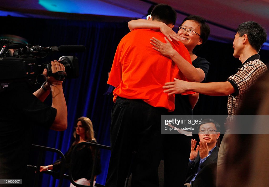 Fourteen-year-old Lanson Tang of Bethesda, Maryland is embraced by his parents after misspelling 'leishmanic' during the final rounds of the Scripps National Spelling Bee June 4, 2010 in Washington, DC. 273 spellers from across the country competed to win the national titile.