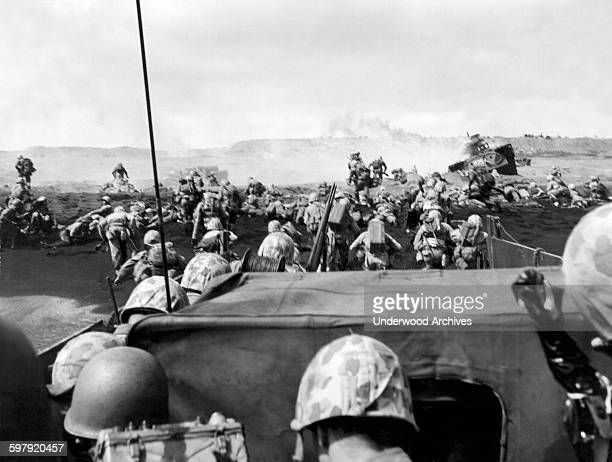 Fourth Division Marines charging from their landing craft onto the beach in the battle at Iwo Jima, Iwo Jima, Japan, March 2, 1945.