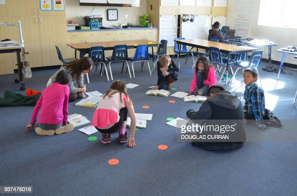 Fourth grade children study english at the Star School a charter educational facility that wants to revitalise the Navajo language and culture on...